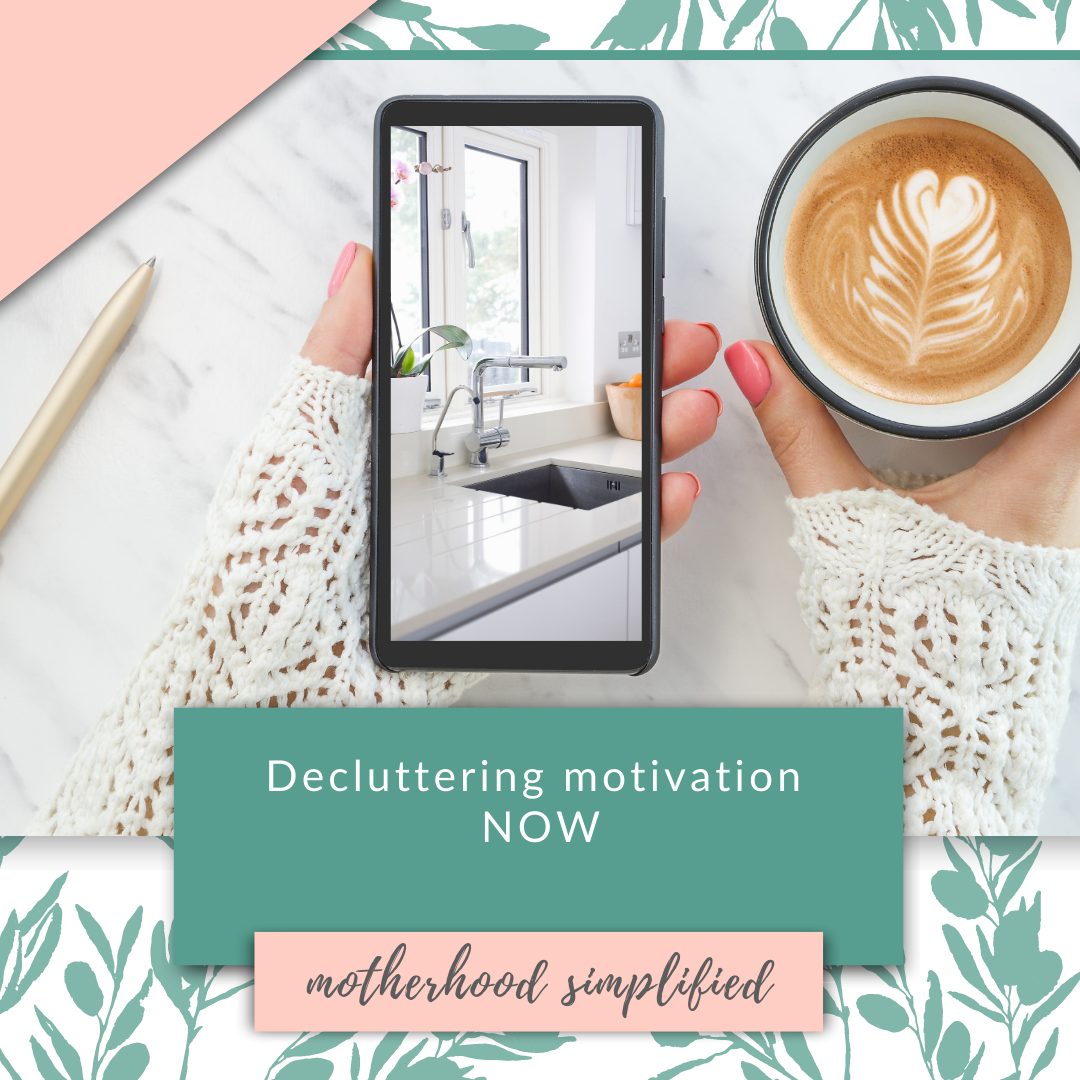"This branded image is a photo of a woman holding a coffee cup, holding a phone with a photo of a clean kitchen. The words on the image say ""decluttering motivation now""."