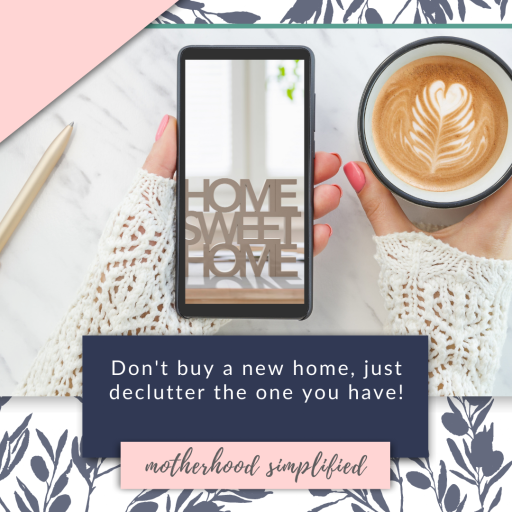 """This branded image has the title """"don'y buy a new house, declutter the home you have now"""". This branded image uses navy and pink color blocks with white text overlayed on flat lay of a smart phone in one hand and a cup of coffee in the other."""