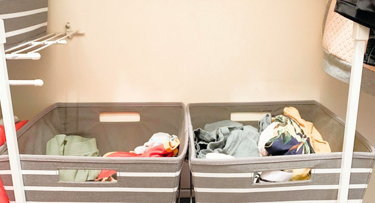 I store baby clothes in shallow fabric bins. I find that the clothing is small enough to fit, easy to keep in my closet, and keeps me on track with responsible consumption amounts.